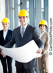 construction manager holding blue print