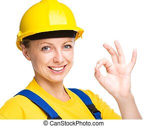 Young construction worker is showing OK sign