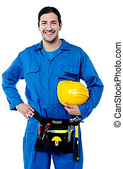 Young construction worker posing confidently