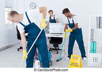 Young contract cleaners - Group of busy contract cleaners...
