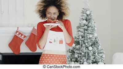 Young cook with a freshly baked Xmas cake