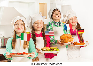 Young cooks with traditional food of their states