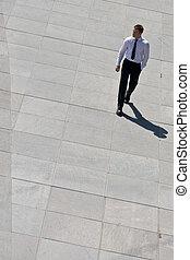 Corporate Man Walking On Pavement