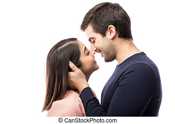 Young couple about to kiss each other