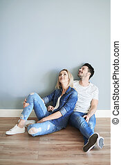Young couple admiring home interior