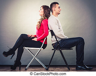 Young couple after quarrel sitting back to back - Bad...