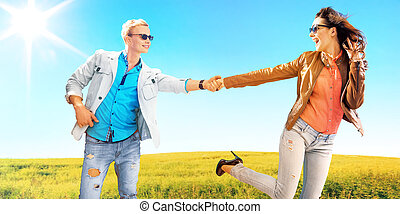 Young couple among the canola fields