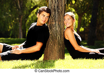 Young couple and a tree