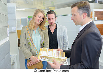 young couple and agent with commercial documents
