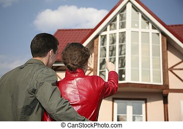 young couple and house