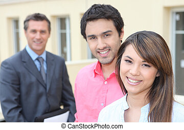 Young couple and real estate promoter
