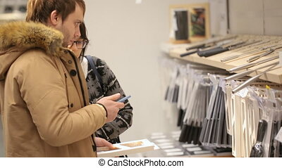 Young couple are choosing crockery at shop