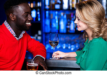 Young couple at bar