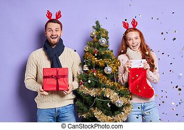 Young couple at christmas party