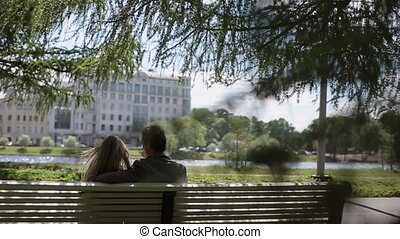 Young couple at date in park