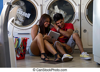 Young couple at laundromat