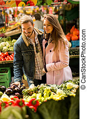 Young couple at market