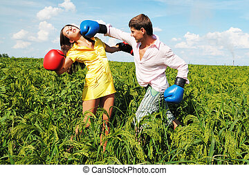 Young couple fighting because they at odds