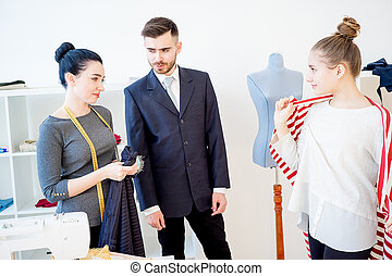 Young couple at tailor shop