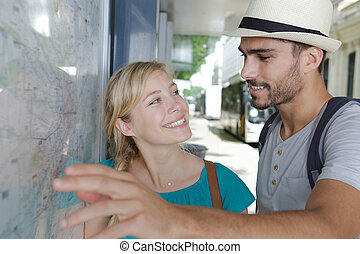 young couple at the bus station