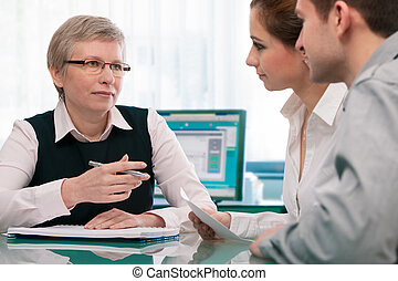 financial planning consultation - Young couple at the ...