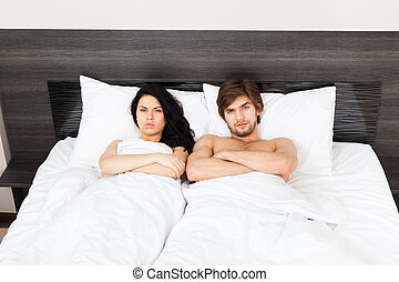 young couple bed - young couple in bedroom, lying at bed