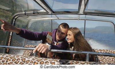 Young couple boating on a romantic trip, a kiss