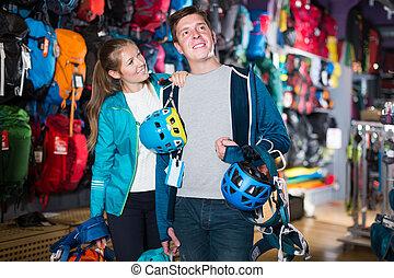couple buy travel gear
