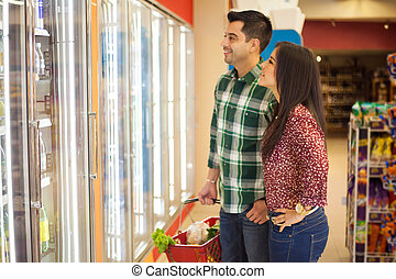 Young couple buying frozen food