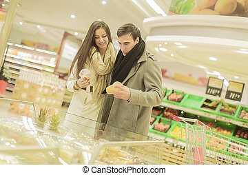 Young couple buying fruits