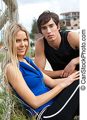 Young Couple By Fence