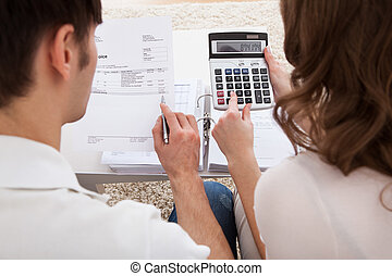 Young couple calculating budget - Portrait of young happy...