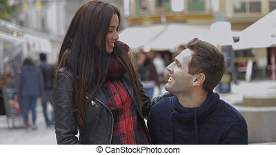 Young couple chatting at a street market or fair