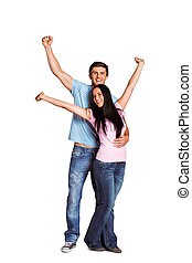 Young couple cheering at camera