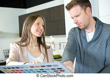 young couple choosing a colour for their walls