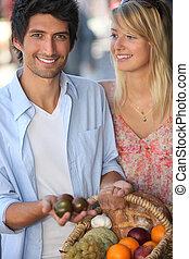Young couple choosing fruit