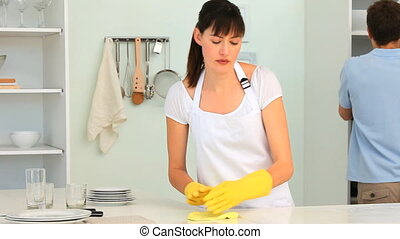 Young couple cleaning the kitchen