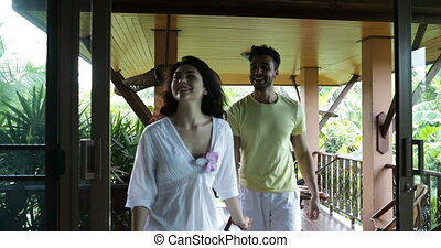 Young Couple Coming Indoors From Summer Terrace Talking, Cheeful Man And Woman Holding Hands Happy Smiling