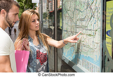 Young couple consulting a map