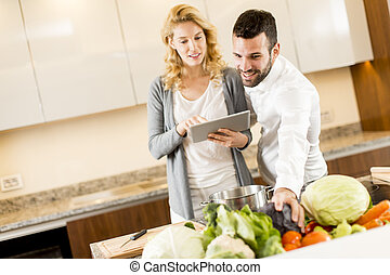 Young couple cooking in the modern kitchen