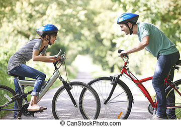 Young Couple Cycling On Country Road