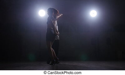 Young couple dance in a dark room with smoke - Young couple...