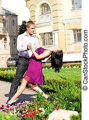 Young couple dancing on street
