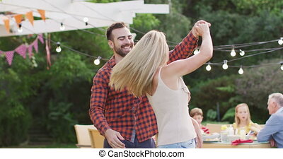 Young couple dancing outdoors
