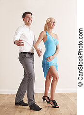 Young Couple Dancing Together
