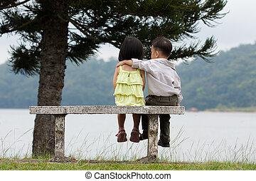 Young couple dating - Two little kids dating with hand lifts...