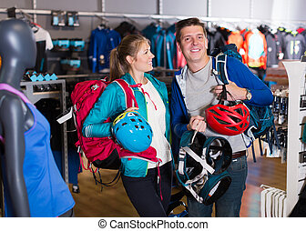 couple demonstrates the selected travel gear