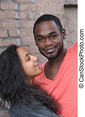Young couple different origins - Young couple smiling and...