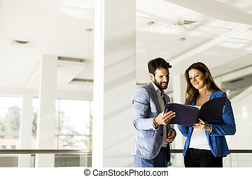 Young couple discussing about business in a modern office