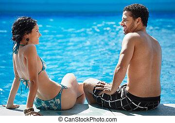 young couple doing honeymoon in resort - Honeymoon: happy...